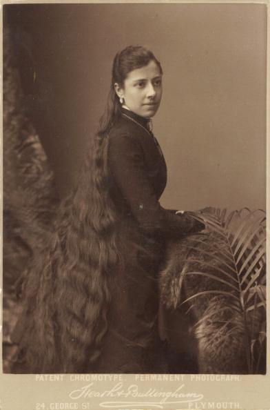 Portrait of a young woman with very long hair, circa 1900s. (Photo by: PYMCA/UIG via Getty Images)
