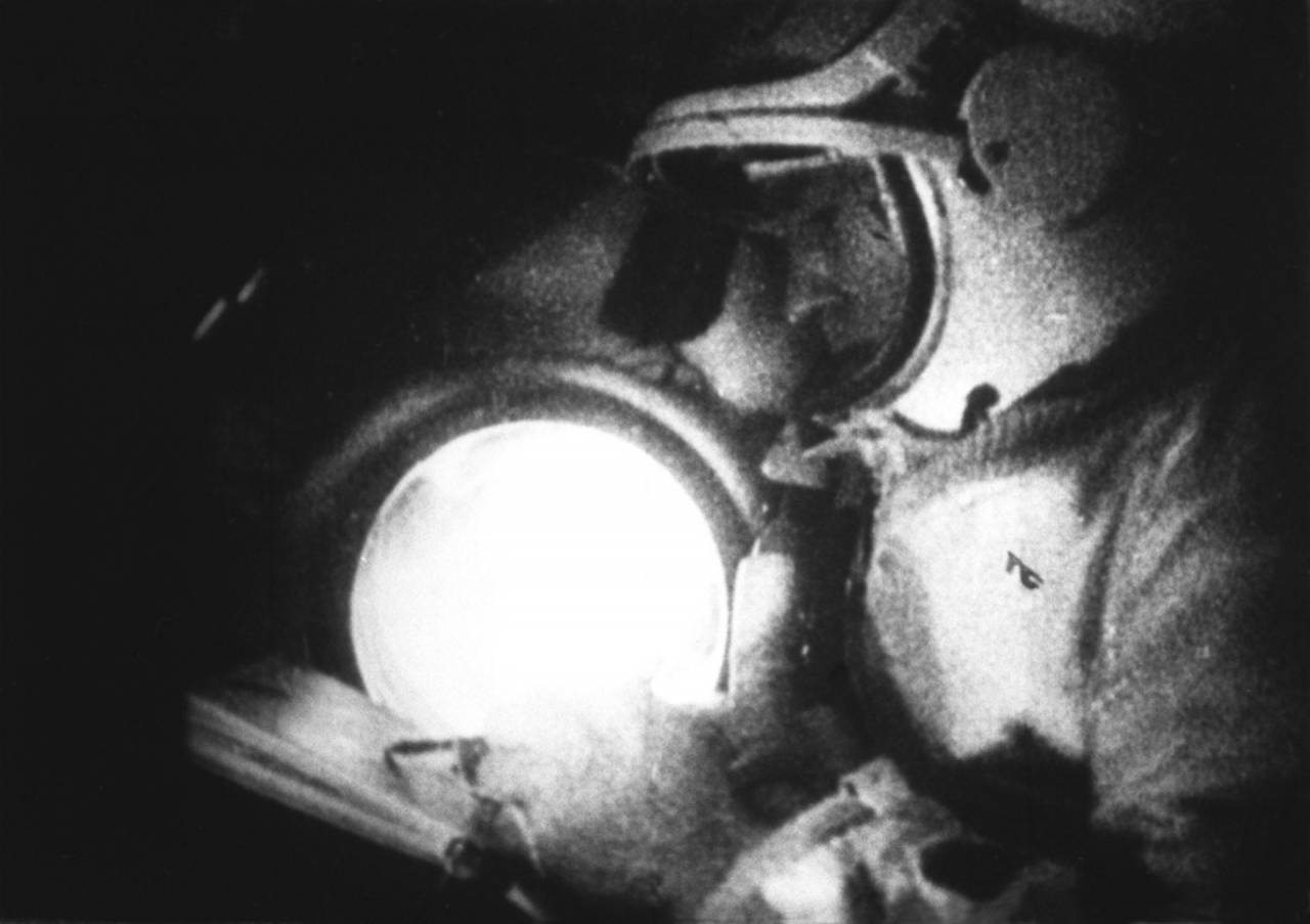 A keen artist, Alexei Leonov draws a sketch of the Earth, while aboard Voskhod 2.
