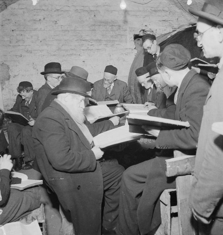East End Wine Merchant's Cellar- A group of Orthodox Jews studying the Talmud Bill Brandt