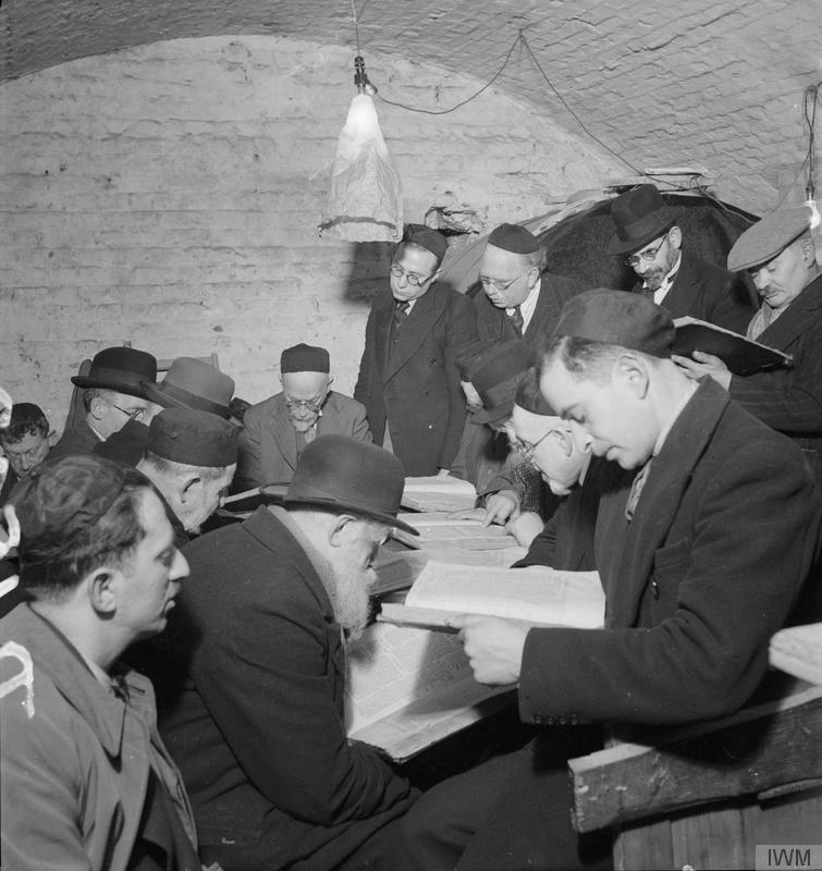 East End Wine Merchant's Cellar- A group of Orthodox Jews studying the Talmud by Bill Brandt