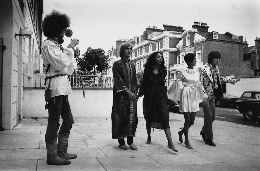 A collection of hippy fashions for girls and boys by Ossie Clark, Alice Pollock and Michael Rainey on show in London, 7th September 1967. Four models wear various styles and 19 year old Niki Kremerovitch looks on. (Photo by Douglas Miller/Keystone/Hulton Archive/Getty Images)