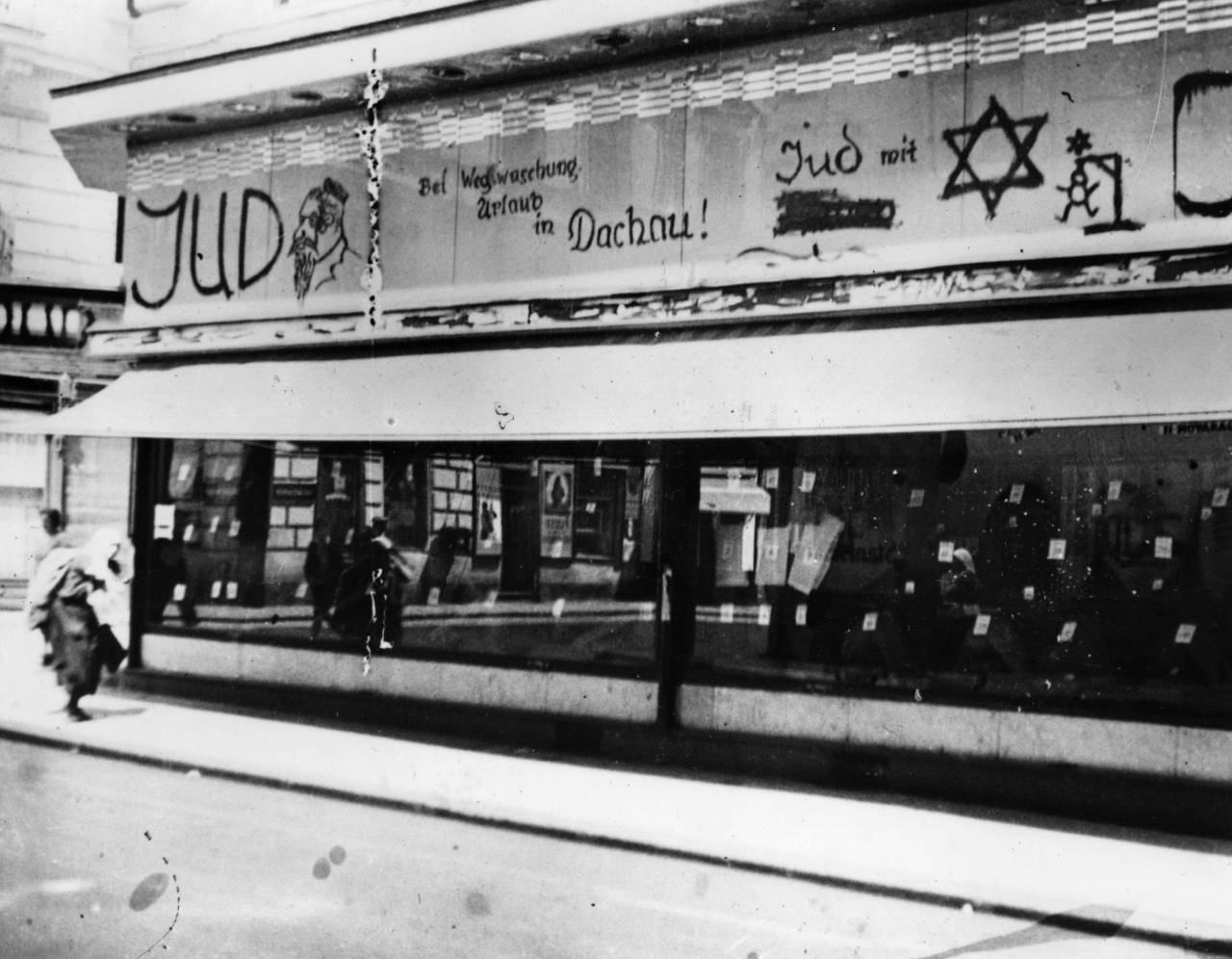 A tailor's shop in the Jewish quarter of Vienna defaced with anti-Jewish slogans by Nazi hooligans. The graffiti carries a warning that the owner will be sent to the concentration camp in Dachau if the obscenities are removed.   (Photo by Keystone/Getty Images)
