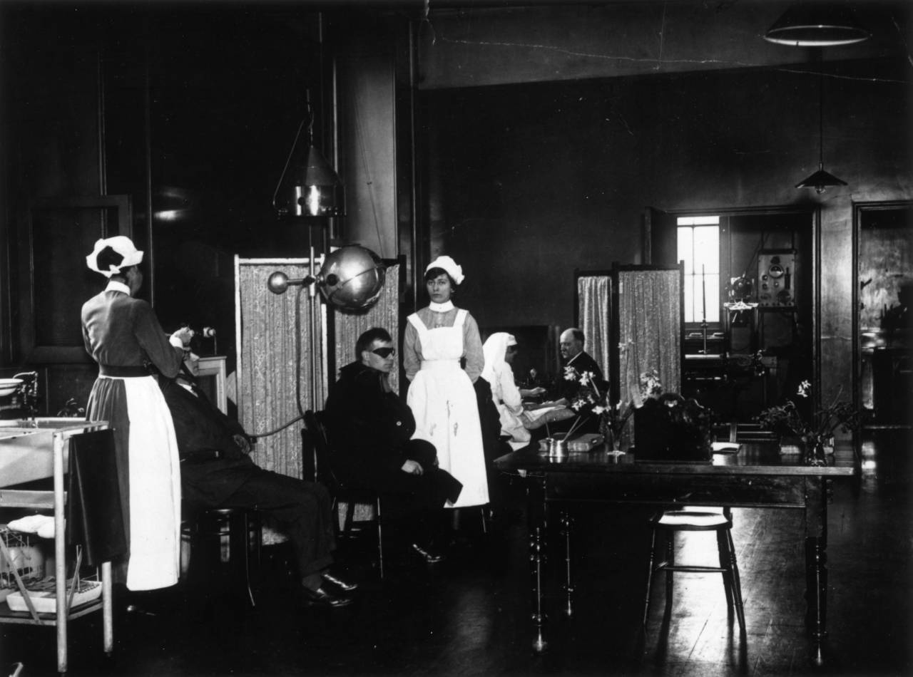 February 1921:  Patients receiving treatment in the Electrical Department of St George's Hospital, Hyde Park Corner, London.  (Photo by A. R. Coster/Topical Press Agency/Getty Images)
