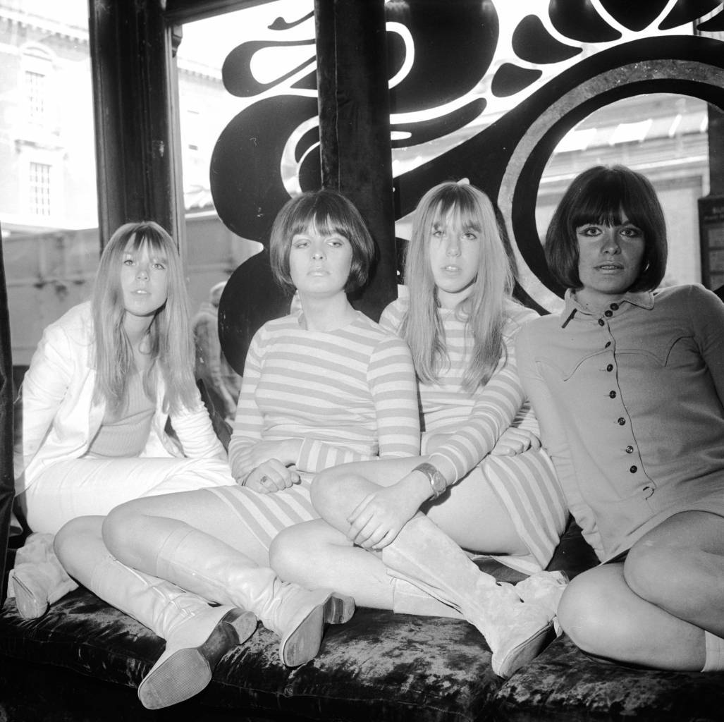 30th September 1966:  Two sets of identical twins who work as shop assistants at Biba's boutique in Kensington, west London (left to right) Michelle Hellier, Susy Young, Nicole Hellier and Rosy Young.  (Photo by Caroline Gillies/BIPs/Getty Images)