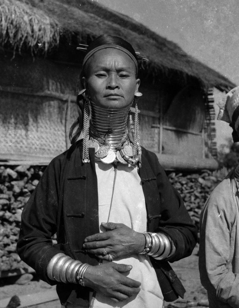 November 1964:  A female member of the Padaung tribe in Myanmar, (formerly Burma), wearing brass rings in order to lengthen her neck.  (Photo by Keystone Features/Getty Images)