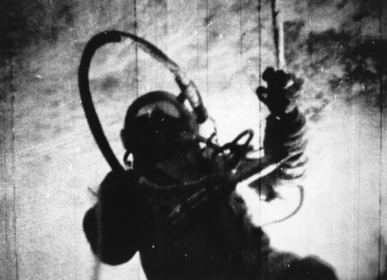 18th March 1965:  Russian astronaut Alexei Arkhipovich Leonov becomes the first man to walk in space, during the 26 1/2 hour orbit of the spacecraft Voskhod 2.  (Photo by Central Press/Getty Images)