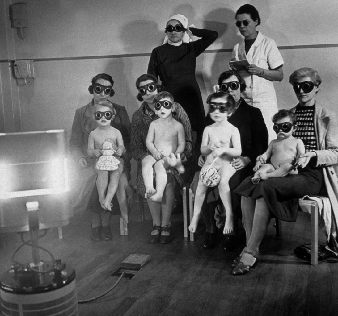 circa 1938:  Children receiving ray treatment at the child welfare centre in Harrow Road, west London.  (Photo by Hulton Archive/Getty Images)