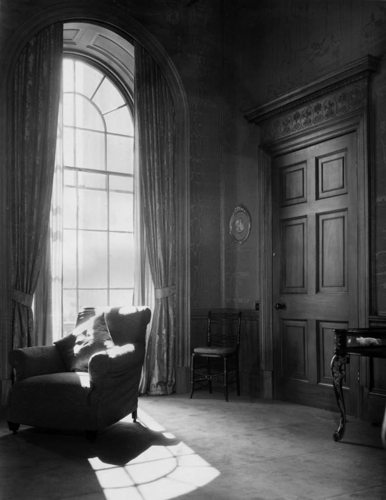 9th September 1932:  A tall arched window letting in rays of sunshine into the drawing room of the eighteenth century house owned by Sir Wyndham Portal.  (Photo by Sasha/Getty Images)