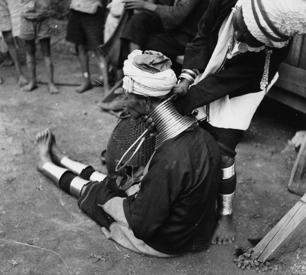 circa 1950:  A Padaung, or Kayan woman has a new brass ring fitted round her neck. The first ring is fitted when they are five or six by a shaman, on a day of horoscopic significance, with successive rings fitted every two years, denoting the status of their family. Originally a Mongolian tribe, the Padaung have been assimilated into the Karen group native to Mayanmar (Burma).  (Photo by Vitold de Golish/Three Lions/Getty Images)