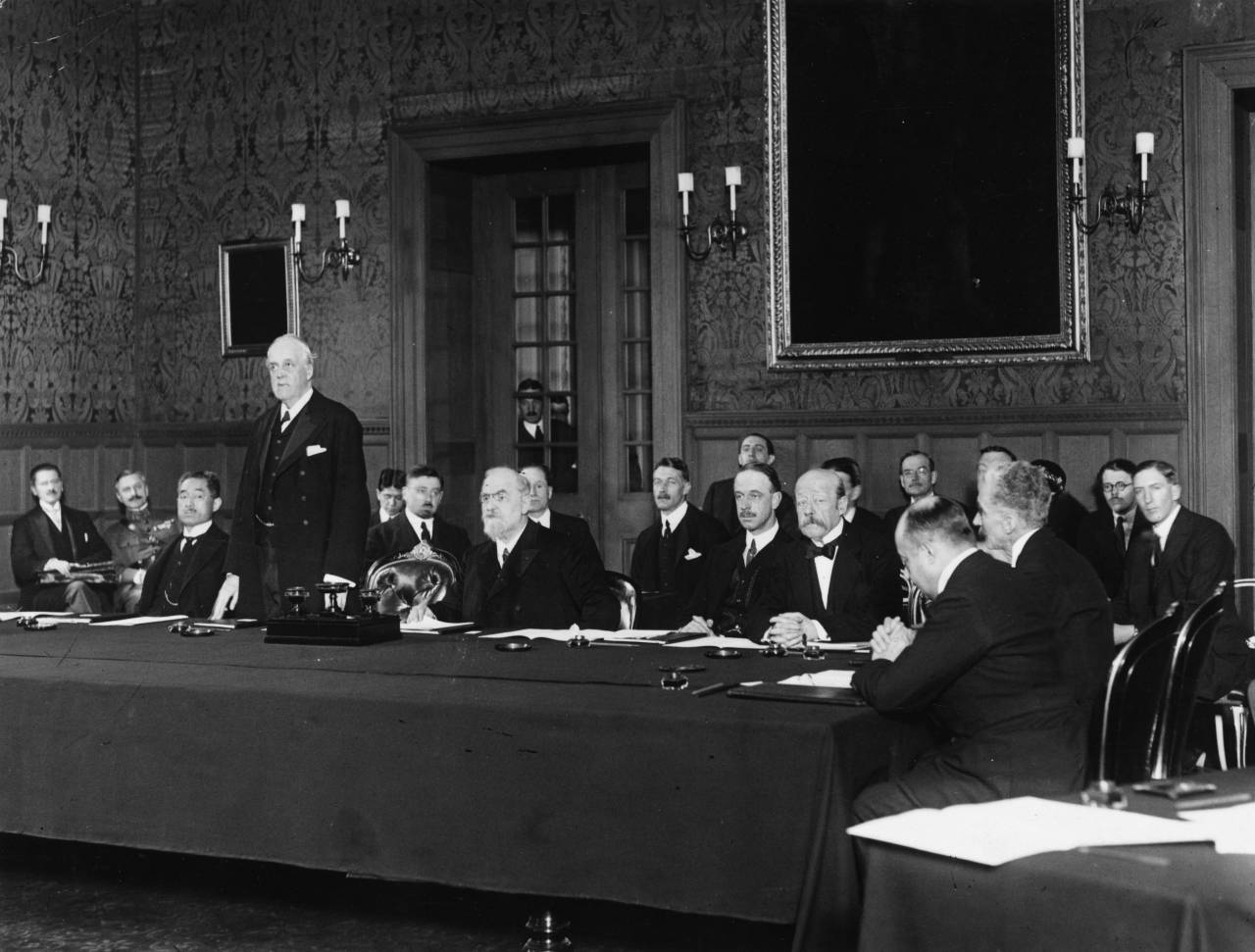 British diplomat and former prime minister Arthur Balfour (1848 - 1930) addressing the first meeting of the Council of the League of Nations in Geneva, November 15, 1920. From left to right - Dimitrios Kaklamanos of Greece, Keishiro Matsui (1868 - 1946) of Japan, Balfour, Leon Bourgeois (1851 - 1925) of France, Maggiorino Ferraris of Italy, Paul Hymans (1865 - 1941) of Belgium, and Jose Maria Quinones de Leon of Spain. The League of Nations first met on 15th November 1920 with representatives from 42 countries. The League had 32 constant members throughout its 20 year existence but 63 nations took part in various assemblies. The League of Nations was eventually superseded by the United Naitons.  (Photo by A. R. Coster/Topical Press Agency/Getty Images)