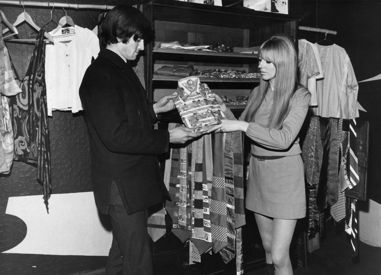 circa 1960:  A shopper inside the Hung On You boutique in Chelsea, London.  (Photo by George Freston/Fox Photos/Getty Images)