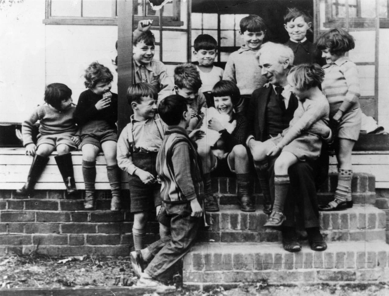 April 1950:  Philosopher, mathematician and author, Bertrand Russell (3rd Earl Russell) (1872 - 1970) with a group of children at Beacon High School.  (Photo by Keystone/Getty Images)