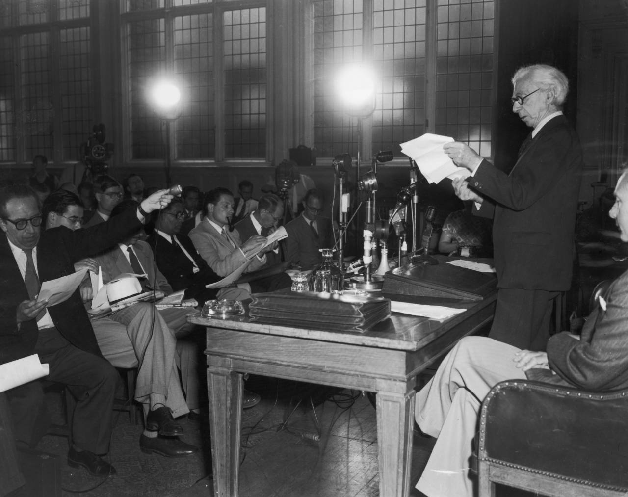 Bertrand Russell, 3rd Earl Russell (1872-1970), hosts a press conference at Caxton Hall, London, to read a statement warning of the perils of nuclear war that has been signed by eminent scientists, 9th July 1955. (Photo by Douglas Miller/Keystone/Getty Images)