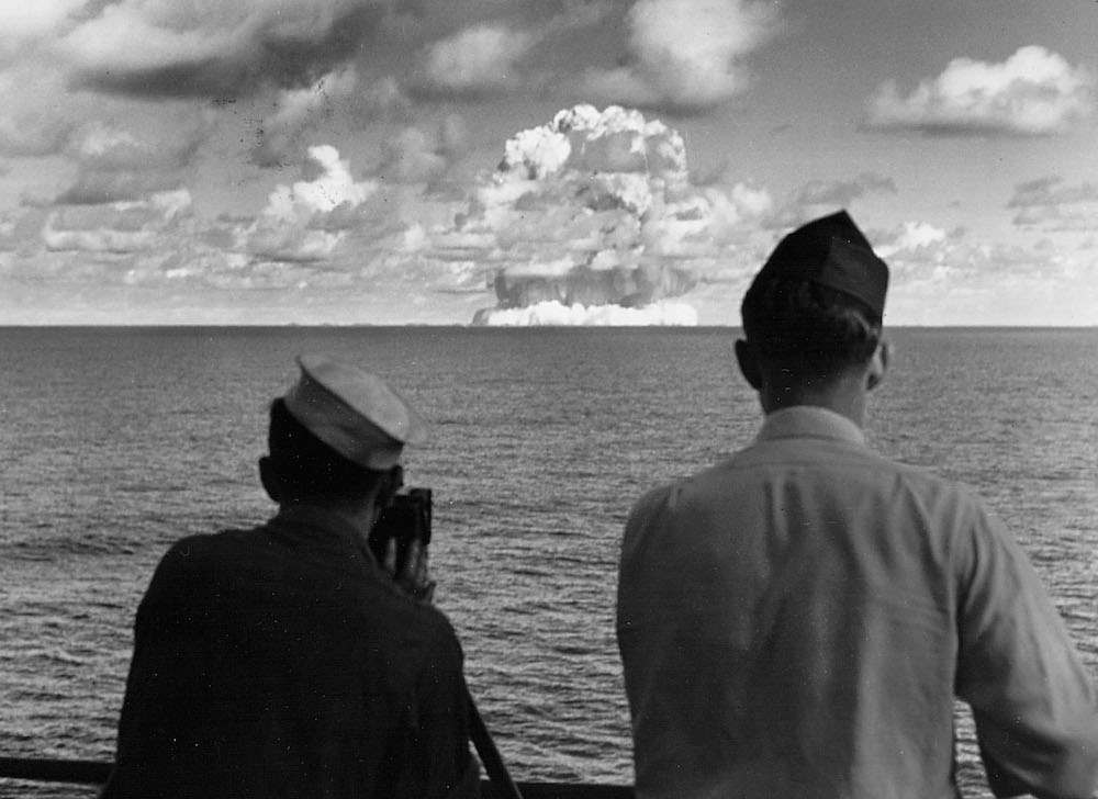"Aboard the USS Mt. McKinley watching an atomic cloud July 25, 1946 during the ""Baker Day"" blast at Bikini Island. (Photo by National Archive/Newsmakers)"