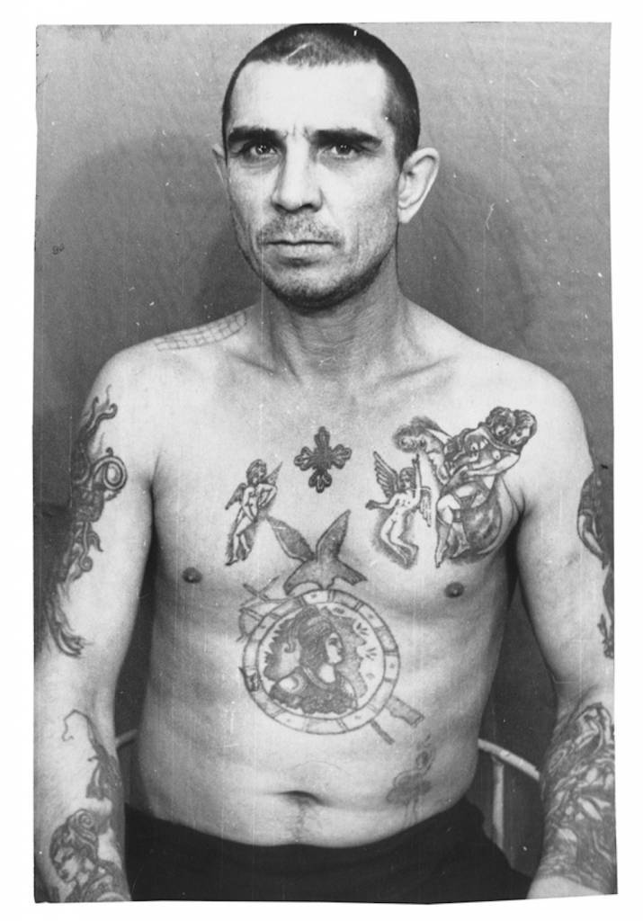 The tattoos on this inmate mimic those of higher-ranking criminals and indicate he has adopted a thieves' mentality. However, he does not wear the 'thieves' stars', he is not a vor v zakone (thief-in-law) and therefore holds no real power among this caste. © Arkady Bronnikov / FUEL