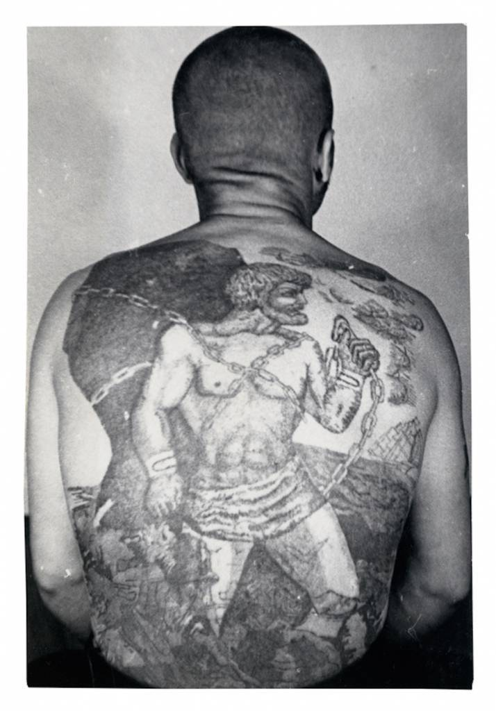 This tattoo is a variation on the myth of Pometheus who, after tricking Zeus, is chained to a rock in eternal punishment. The sailing ship with white sails means the bearer does not engage in normal work, he is a travelling thief who is prone to escape. © Arkady Bronnikov / FUEL