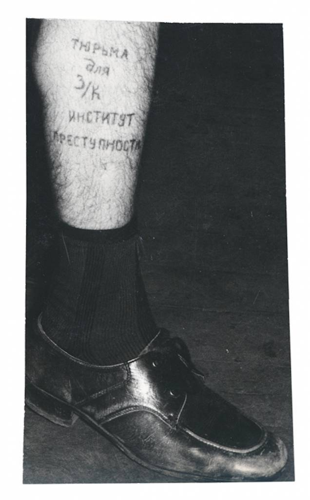 Text on the leg reads 'Prison for a zek is a university of crime'. This tattoo means that an ordinary person who is sentenced for a minor offence will inevitably improve his criminal skills in prison, as professional criminals share their experience. For example, pickpockets reveal how to make sure the victim feels nothing as their pockets are emptied of valuables. Even if a person has committed a crime in error, when he leaves prison he will be more likely and able to commit crimes purposefully and professionally. The reality is that penal institutions don't correct inmates, even though they were once called 'Correctional Labour Institutions'. Today they are known as 'Institutions for the Execution of Sentences', so they are no longer required to deal with the problem of correction. © Arkady Bronnikov / FUEL