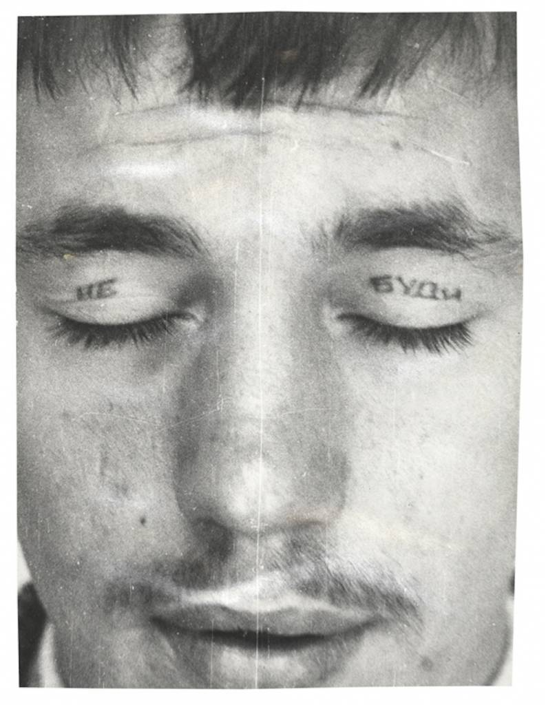 Text across the eyelids reads 'DON'T / WAKE'. Eye tattoos are made by inserting a metal spoon under the eyelid so that the 'needle' doesn't pierce the eye. © Arkady Bronnikov / FUEL