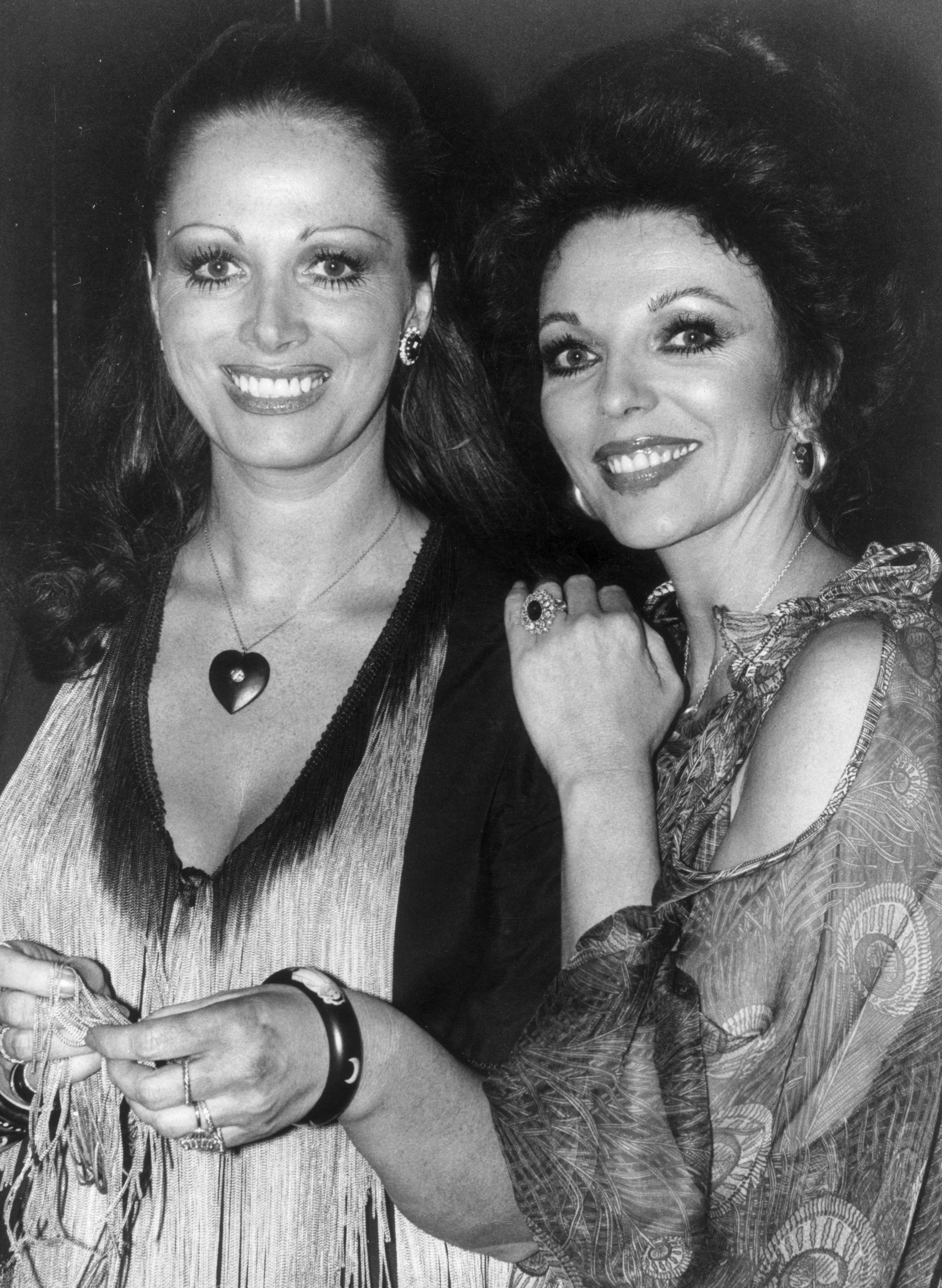27th September 1977:  British actress Joan Collins and writer Jackie Collins at a party celebrating the release of 'The Stud', a film based on a novel by her sister.  (Photo by Jones/Evening Standard/Getty Images)