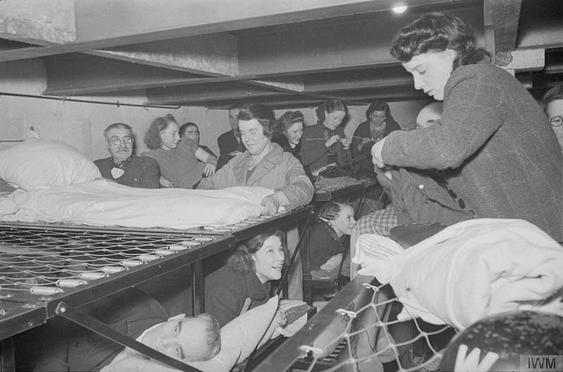 Shelterers knit and chat on their steel bunks in this North London air raid shelter Bill Brandt