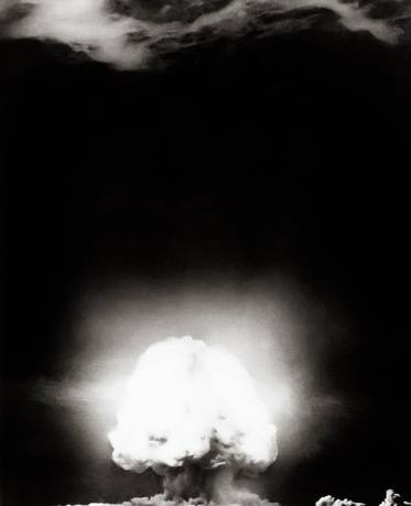 The world's first atomic bomb detonated at the Trinity site in Alamogordo, southern New Mexico, July 16, 1945. The fast-rising incandescent cloud produced by explosion illuminated the skies.