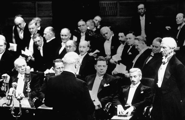 Circa 1950: Novelist William Faulkner (2nd R) in white tie and tail surrounded by participants in Nobel Prize ceremonies, including Bertrand Russell (R).  (Photo by Cornell Capa/The LIFE Picture Collection/Getty Images)