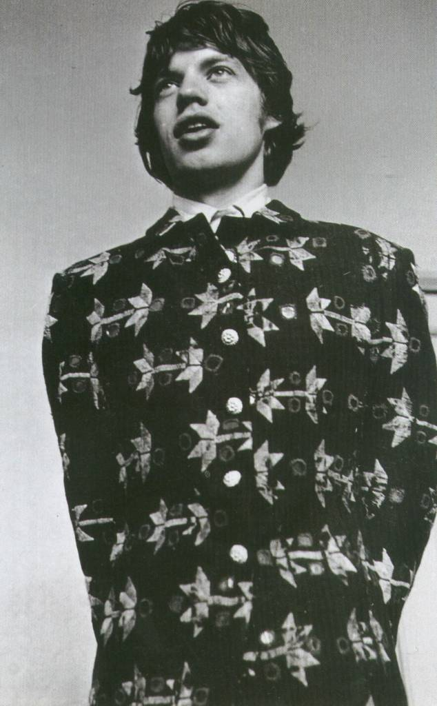 """This photo of Mick trying on a new jacket was taken by Bob Whitaker in 1967 in Chelsea boutique Hung On You, where Jagger (and a lot of other 60's pop stars) was a frequent customer. As Bob Whitaker remembers: Hung on You was just around the corner from my studio and it was always full of pretty girls. There was a lot of paranoia surrounding the shop. The clothes were very flamboyant and the police took that as an excuse to bust you"""" ( Q magazine, special edition, Feb 2005).  Via A DandyInAspic"""