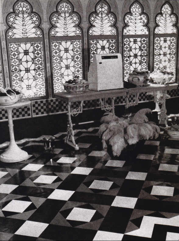 Part of the conservatory area in the third Biba shop, 124-126 Kensington High Street, designed by Antony Little, using stained glass windows which had been reclaimed from St Paul's school. (1969).