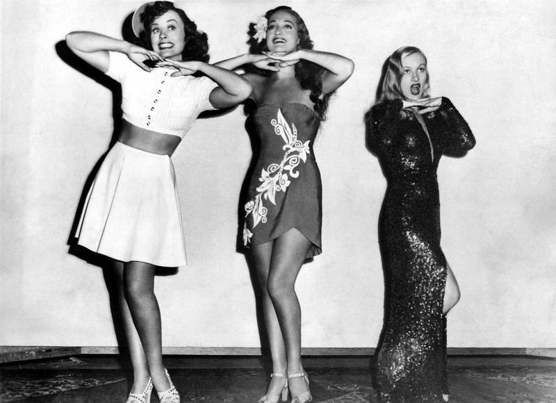 "To get an idea of how tiny Veronica Lake was, she is shown here with fellow film stars Paulette Goddard (l) and Dorothy Lamour (center). Lake is at our far right. From movie, ""Star-Spangled Rhythm,"" 1942."