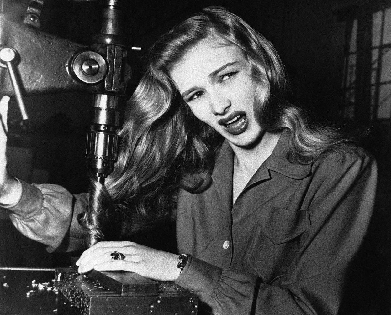 American film actress Veronica Lake illustrates what can happen to women war workers when they don't wear their hair back while working at factories, 1943 (via Retronaut)