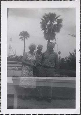 1955 photo family palm trees double exposure