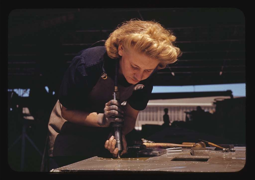 Working in the Assembly and Repair Dept. of the Naval Air Base, Corpus Christi, Texas 1942