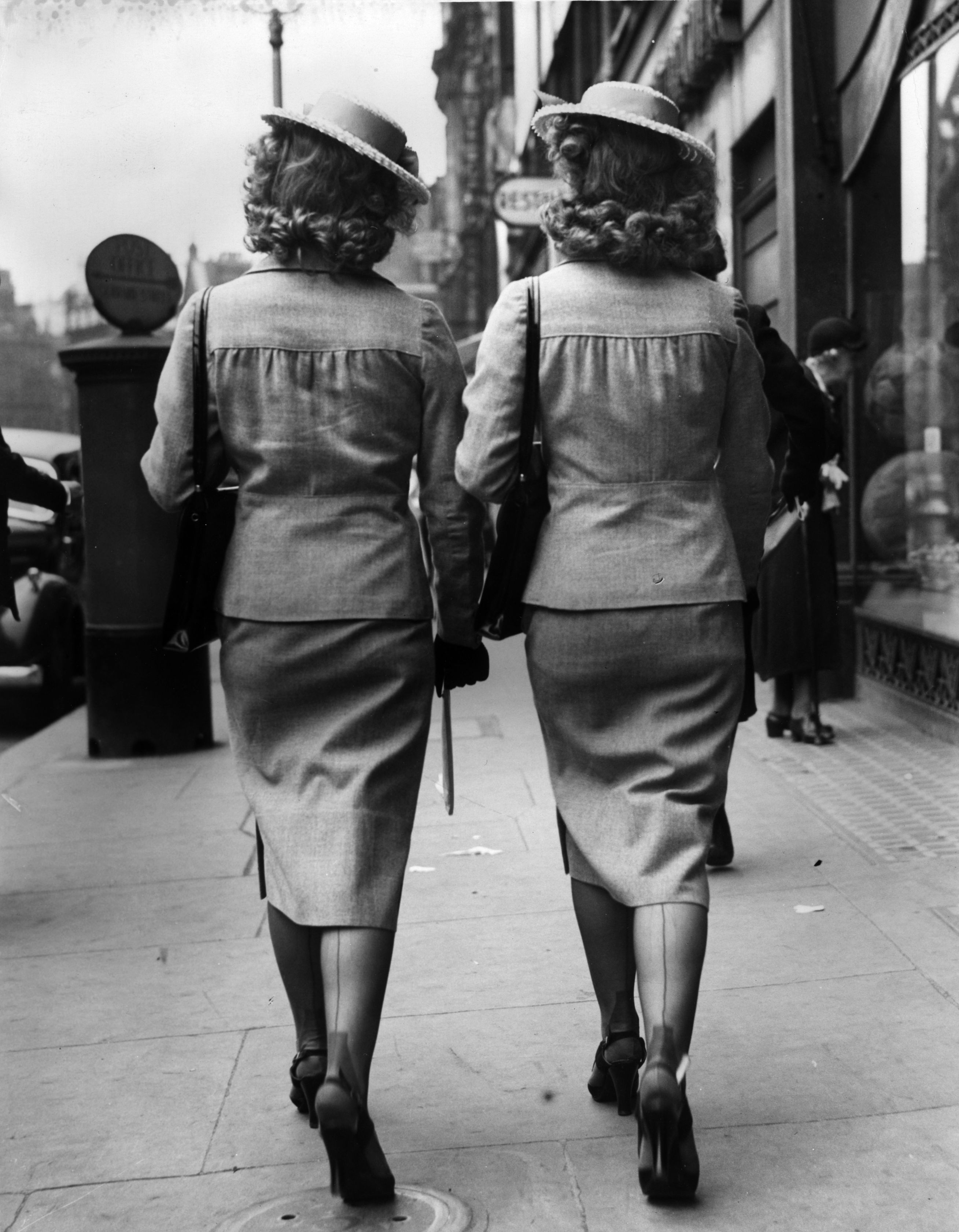 27th May 1939:  The Henderson twins of radio and music-hall fame on a shopping expedition in Shaftsbury Avenue, London.  (Photo by A. J. O'Brien/Fox Photos/Getty Images)
