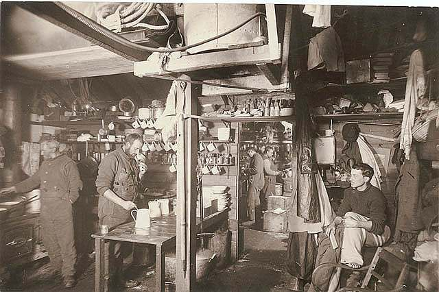 Australian Antarctic Expedition members in the kitchen, 1911-1914