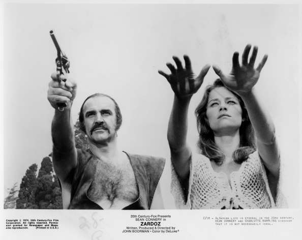 "CIRCA 1974: Sean Connery and Charlotte Rampling walk in a scene from the 20th Century Fox movie ""Zardoz"" circa 1974. (Photo by Hulton Archive/Getty Images)"