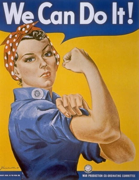 1942: WWII patriotic We Can Do It poster by J. Howard Miller featuring woman factory worker in bandana rolling up her sleeve & flexing her arm muscles. (Photo by Time Life Pictures/National Archives/The LIFE Picture Collection/Getty Images)