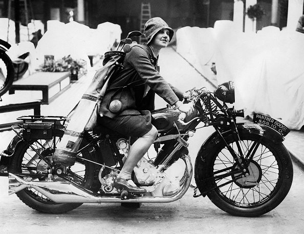 (GERMANY OUT) Motorcycles Young woman with on a motorcycle with a golf bag on her back - 1928 - Vintage property of ullstein bild (Photo by ullstein bild/ullstein bild via Getty Images)