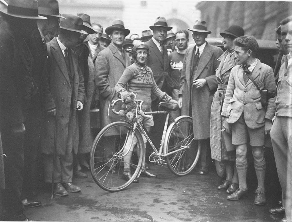 "Billie Samuels leaving to ride to Melbourne on a Malvern Star bicycle, 4 July 1934, by Sam Hood ""Miss Billie Samuels started on her attack on the women's record iiom Sydney to Melbourne, held by Miss Valsa Barbour, at 10 o'clock yesterday morning. She will ride to a schedule which will bring her to the Melbourne G.P.O. at 2 p.m. on Saturday, in total time of 3 days 7 hours."