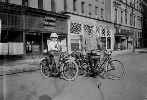 UNITED STATES - CIRCA 1910:  Portrait of two motorcyclists, a man and a woman, standing together with their vehicles, ca1910, United States (Photo by Nathan Lazarnick/George Eastman House/Getty Images)