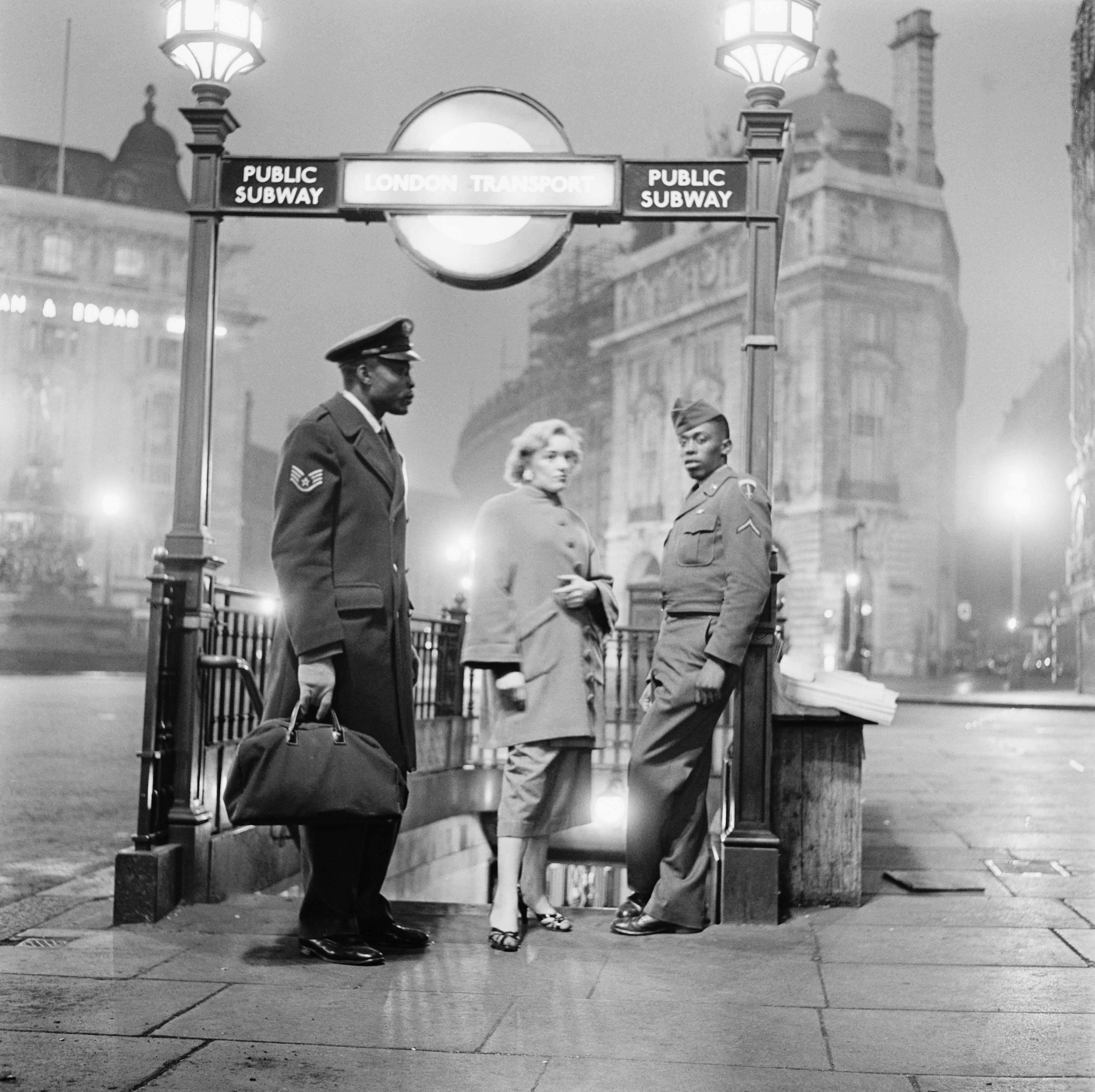 After leaving the 'Club Americana', a Saturday night jazz club open from midnight until 7 a.m., American troops and their girlfriends wait at Piccadilly Circus Station for the first train home, London, 25th November 1955. (Photo by Keystone Features/Hulton Archive/Getty Images)