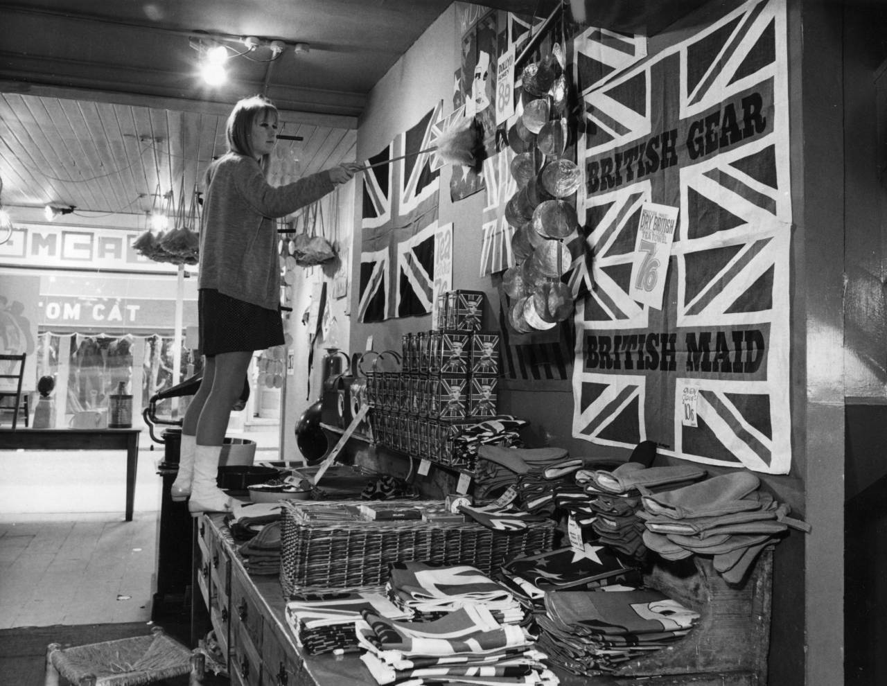 A woman doing some dusting in the Carnaby Street shop 'Gear'.   (Photo by Fox Photos/Getty Images)