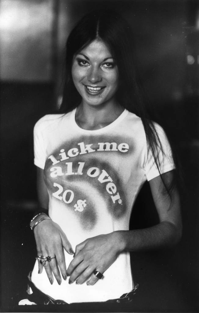 Vikki wearing a seventies t-shirt with the slogan 'lick me all over $20'. (Photo by M Fresco/Getty Images)