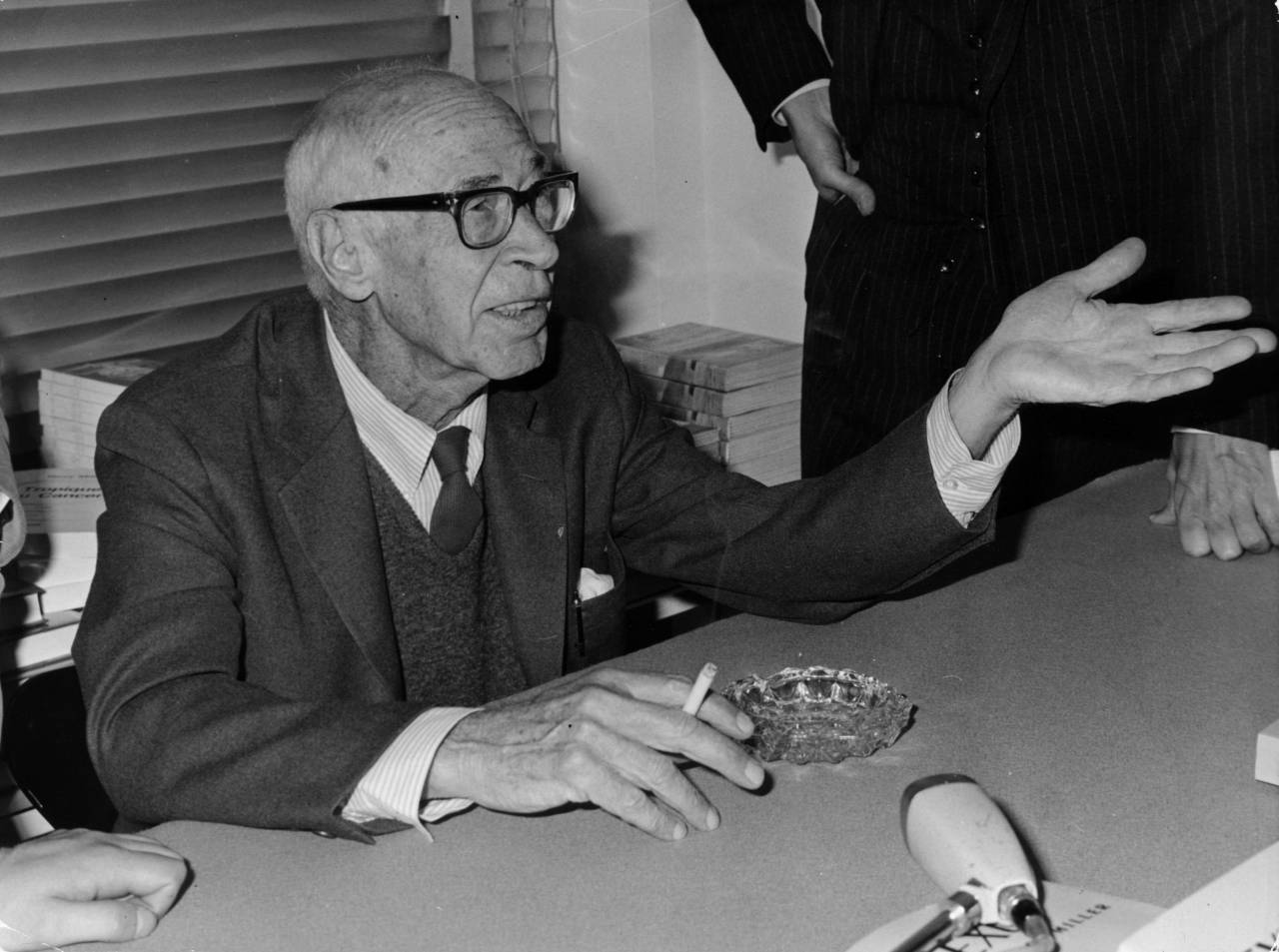 22nd September 1967:  Author Henry Miller (1891 - 1980) at the Daniel Gervis Gallery, Rue du Bac, Paris where his paintings and engravings, which he produced in his later years, are on show.  (Photo by Keystone/Getty Images)