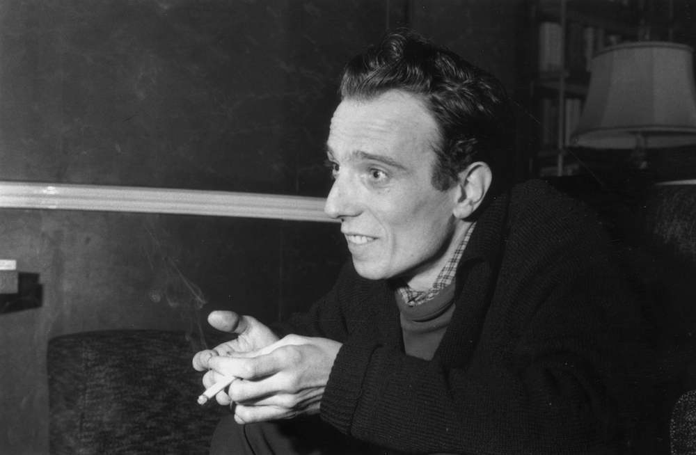 10th March 1958:  Poet, playwright and actor Christopher Logue.  (Photo by Alan Meek/Express/Getty Images)