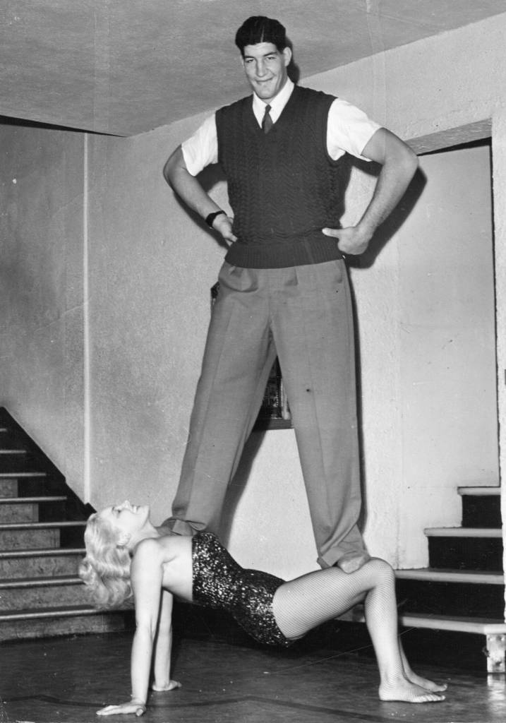 11th August 1955: Larger-than-life Ewart Potgieter balances on strong woman Jean Rhodes. (Photo by Keystone/Getty Images)