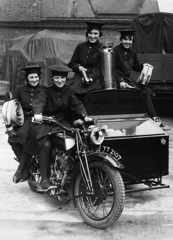 circa 1925:  Women of Achille Serre Ltd's Private Fire Brigade setting off on their motorcycle and sidecar to compete in the London Private Fire Brigades' Tournament. They are defending champions in the women's events.  (Photo by Hulton Archive/Getty Images)