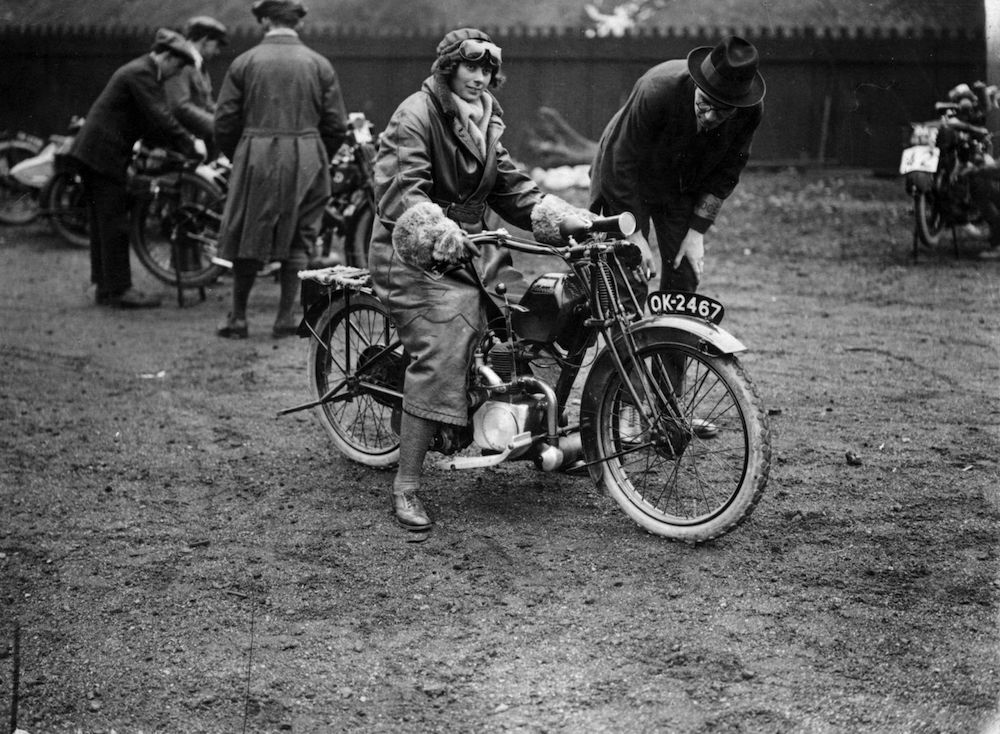 March 1923:  A woman on a Velocette motorcycle at the ACU Trials in Birmingham.  (Photo by Topical Press Agency/Getty Images)