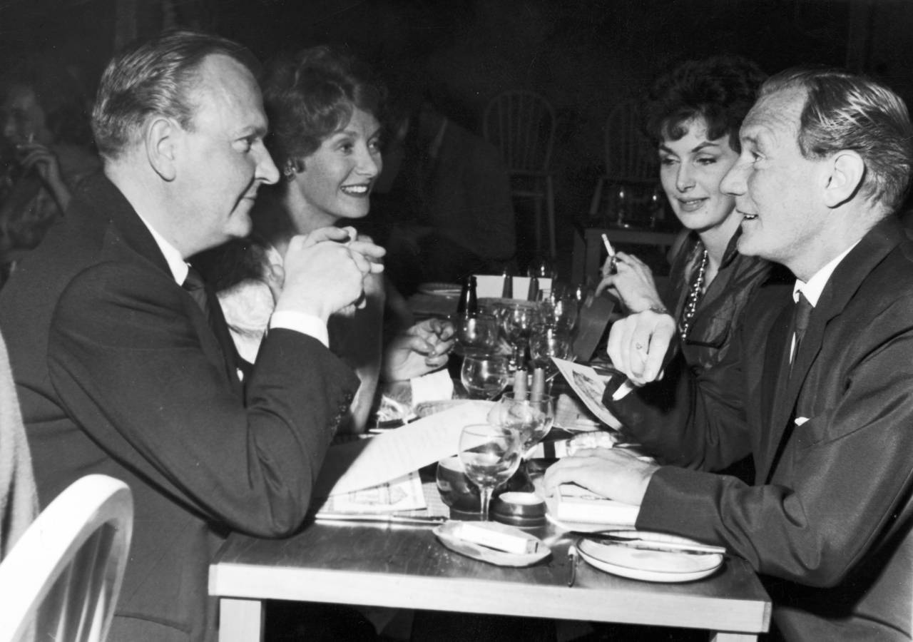 English film actor Trevor Howard (1916 - 1988) with friends at at the opening night of 'The Establishment' - Peter Cook's satire club in Soho, London, 6th October 1961. Left to right: Brian Longhurst, Helen Cherry, Mrs Longhurst and Trevor Howard. (Photo by Keystone/Hulton Archive/Getty Images)