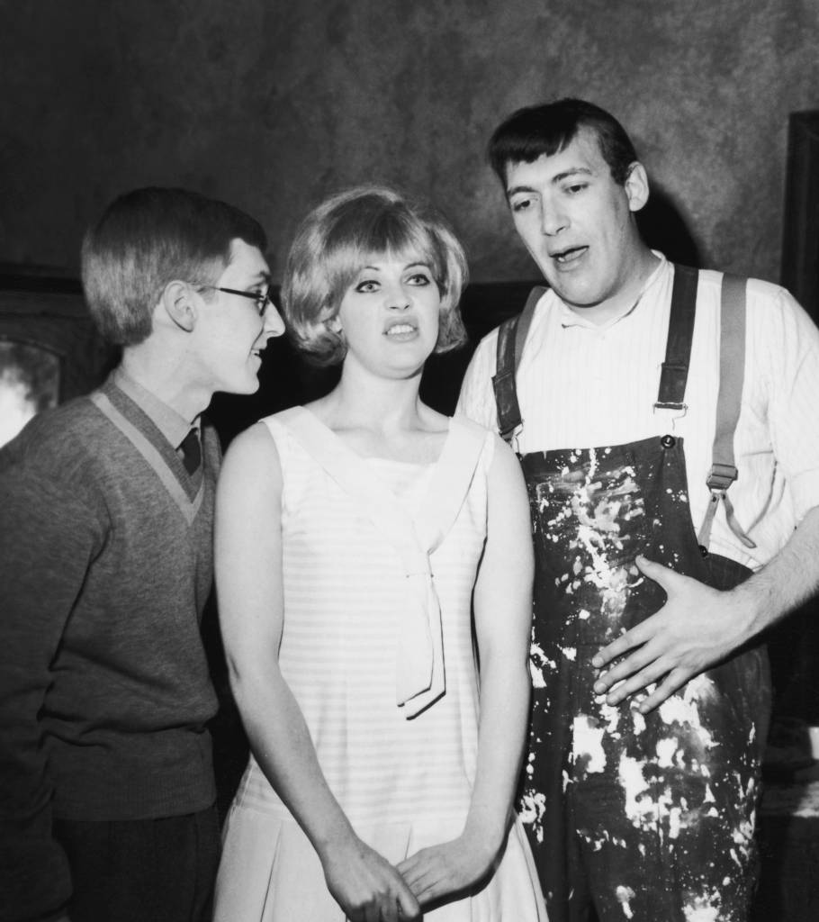 Artist and actress Pauline Boty (1938 - 1966) stars as 'the girl with the golden bra' in the Frank Hilton comedy 'Day of the Prince' at the Royal Court Theatre, 13th May 1963. Rehearsing with her are Christopher Sandford (left) and Bernard Bresslaw (1934 - 1993). (Photo by Chris Ware/Keystone/Hulton Archive/Getty Images)