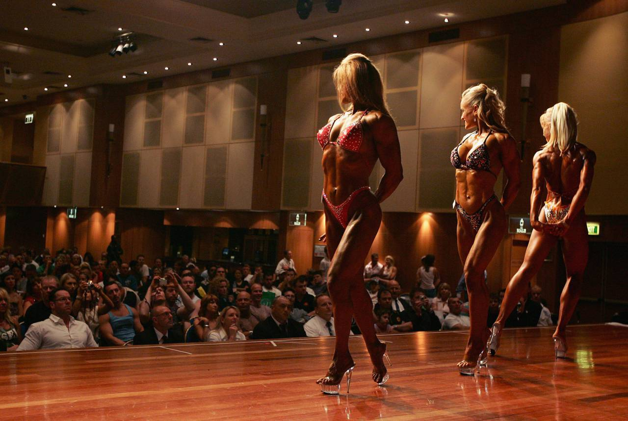 SYDNEY, NSW - OCTOBER 30: Competitors perform poses for judges during the womens open bodybuilding division during the Australian Bodybuilding and Bodyshaping Championships at Revesby Workers Club October 30, 2005 in Sydney, Australia. (Photo by Cameron Spencer/Getty Images)